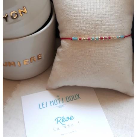 Bracelet au message codé Rêve ta vie - framboise